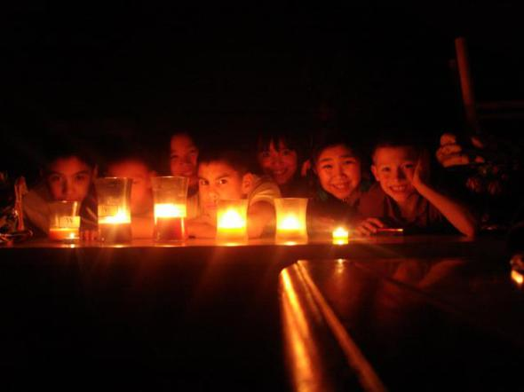 Kids in the candle light