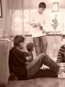 Dorian and Jrew watching Jase open his big $$ gift, limit $2.