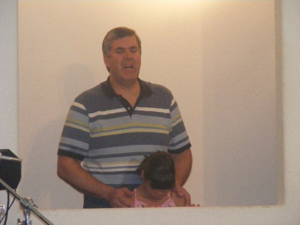 Pastor Brown praying before the baptism