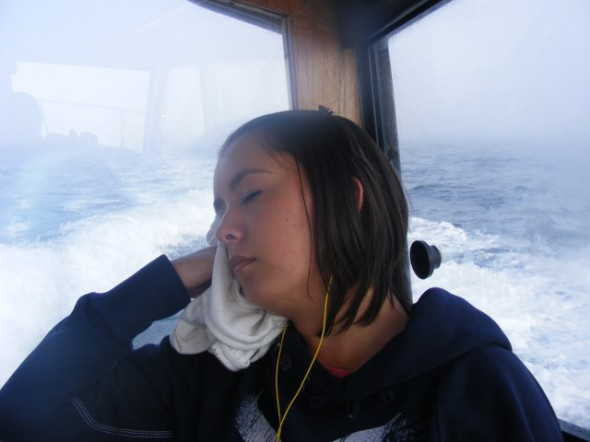 Alli on the boat doing the same thing she does at home.